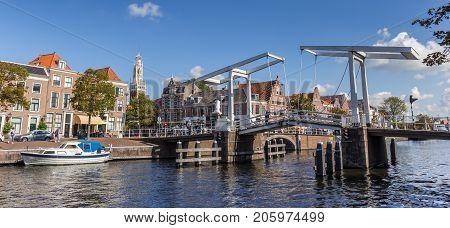 HAARLEM, NETHERLANDS - SEPTEMBER 03, 2017: Panorama of an old bridge in the center of Haarlem Netherlands