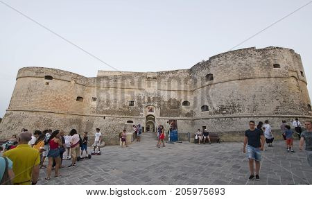 OTRANTO ITALY - JULY 24 2017: people in front of the De Monti Castle of Corigliano d'Otranto often used for exhibitions and event