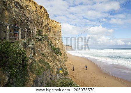 Melbourne, Australia: April, 2017: Tourists enjoy the views from the beach near the Twelve Apostles, Great Ocean Road. They have walked down Gibson's Steps which is the only safe access to the beach.