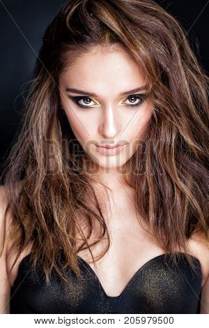 Beautiful Fashion Model Woman with Brown Hair and Golden Eyeshadow