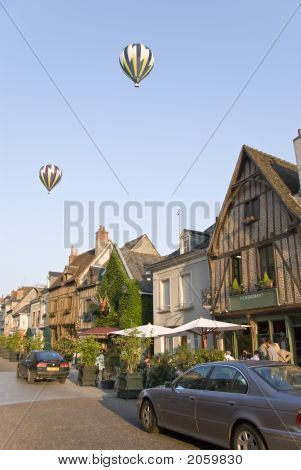 Street in Amboise. Two balloons flying above. Loire Valley France poster