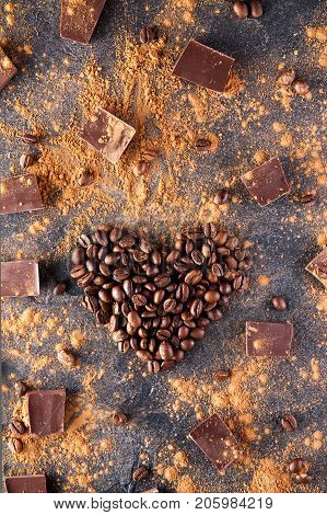 Roasted Coffee Beans In The Shape Of A Heart On The Dark Stone Background With Dissipate Cocoa, Piec