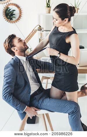 Woman Pulling Man By Necktie