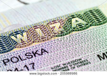 Close up of visa in passport. Poland of shengen travel concept.