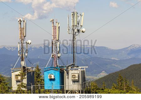 Mobile telecommunication tower or cell tower with antenna and electronic communications equipment in carpathian mountains