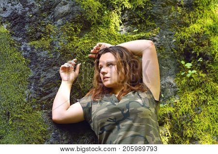 young woman in jungle. happy young woman backpacker looking at the waterfall in jungles. Ecotourism concept image travel girl