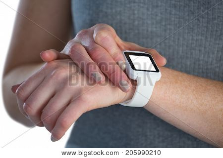 Close up of businesswoman adjusting smart watch while standing against white background