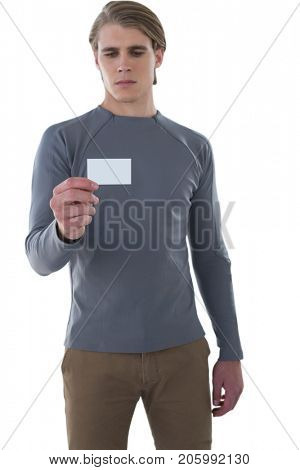 Businessman reading card while standing against white background