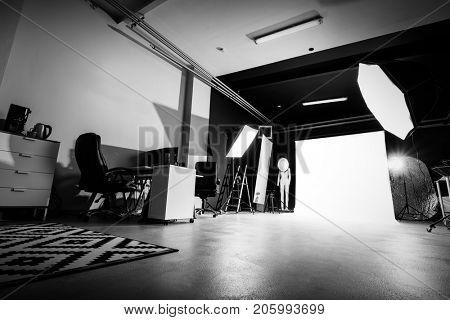 Photo studio interior with lighting equipment. Professional photography. Creative space