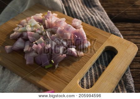 Close-up of chopped onions on a chopping board
