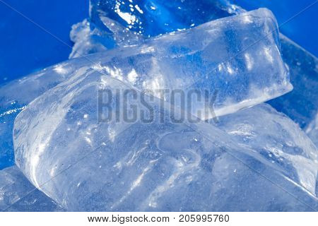 background of cold blue ice . Photo of an abstract texture