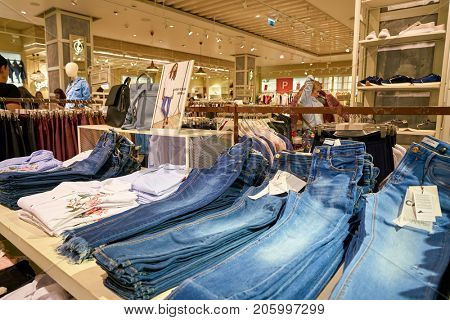 SAINT PETERSBURG, RUSSIA - CIRCA AUGUST, 2017: jeans on display at Stradivarius store at Galeria shopping center. Stradivarius is an international women and men clothing fashion brand