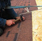 Asphalt Shingles Roof Installation.  Roofer Install Asphalt Roofing Shingles. Roof Shingles - Roofing Construction, House Roofing Repair. poster