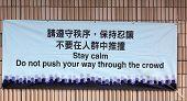 Banner 'Don't push your way through the crowd'. Tsim Sha Tsui Hong Kong. poster