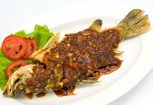 Fried snapper with chili sauce on the plate poster
