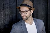 Smart hat on handsome chap in glasses looking away poster