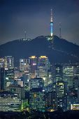 Seoul downtown cityscape illuminated with lights and Namsan Seoul Tower in the evening view from Inwang mountain. Seoul, South Korea. poster