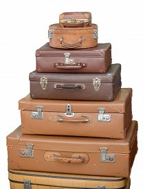 Seven old suit case isolated on white background.