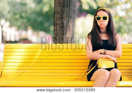 Bored Woman Waiting For Her Date Alone On A Bench