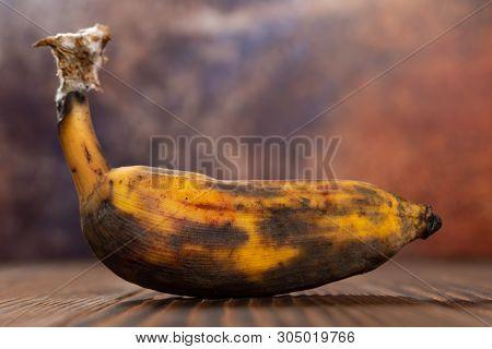 An Overripe Banana On A Wood Table