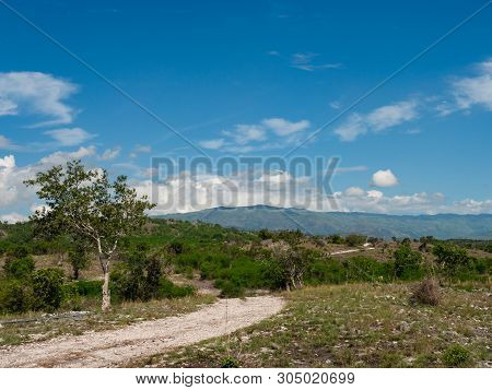 Dry Mountain Landscape With Dirt Road In Maasim, Sarangani Province On Mindanao, The Southernmost La