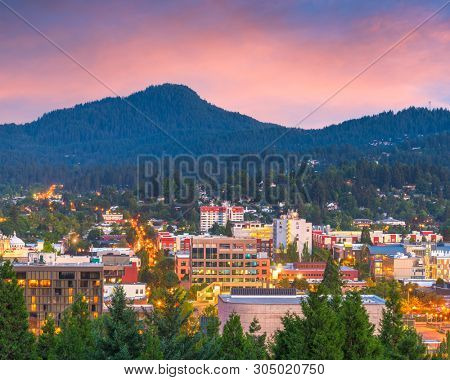 Eugene, Oregon, USA downtown cityscape at dusk.