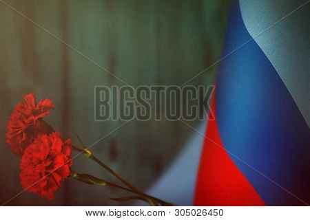 Luhansk Peoples Republic Flag With Two Red Carnation Flowers For Honour Of Veterans Or Memorial Day