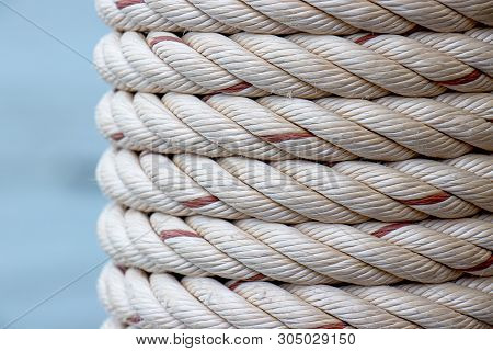 Detail Of White Ship Rope Wrapped Around The Pole At Fishing Port, Pattern Background