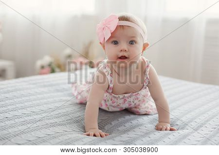 Adorable Baby Boy In White Sunny Bedroom Plays Alone On The Bed.charming Beautiful Lovely Small Fema