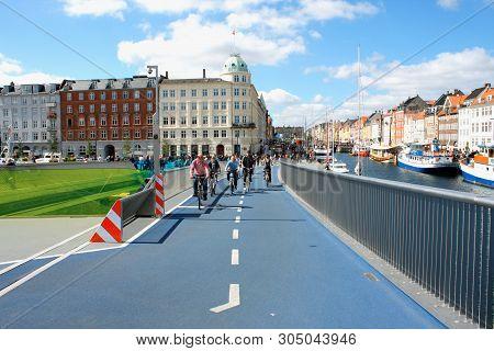 Copenhagen, Denmark: May 12, 2019 - People On Bikes Drive On Inderhavnsbroen Bridge In Copenhagen Ny
