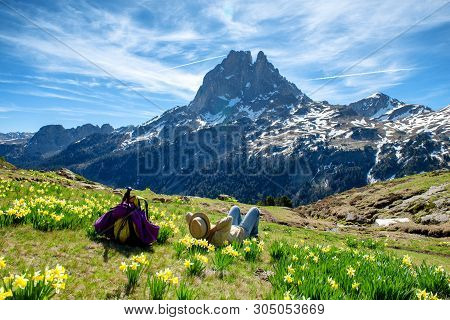An Hiker Woman Resting And Looking The Pic Du Midi Ossau In The French Pyrenees Mountains