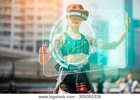 Sports Technology Concept.beauty Asian Woman Running By Virtual Reality In The City. Vr Headset Glas