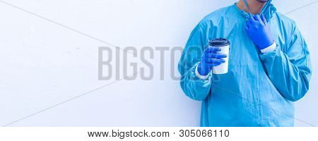 Doctor In Blue Scrubs Relaxing With Coffee Break.doctor Or Medic Holding Coffee To Go Cup Isolated O