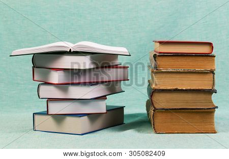 Open Book, Stack Of Hardback Books On Table. Back To School. Copy Space
