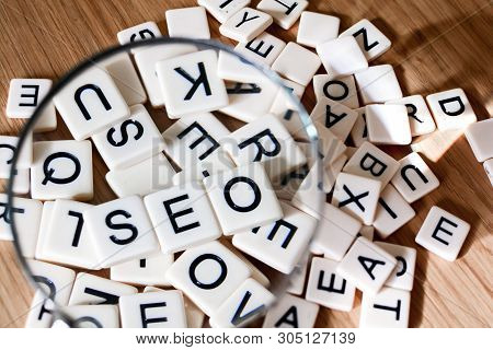 Seo Concept With Magnifying Glass Over Seo Text Spelled Out From Mixed Letters