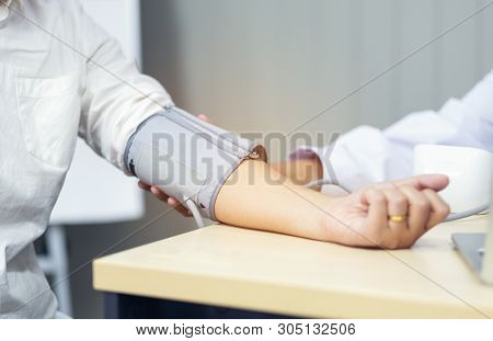 Doctor Checking Blood Pressure Of The Patient, Selective Focus, Health Care In Clinic