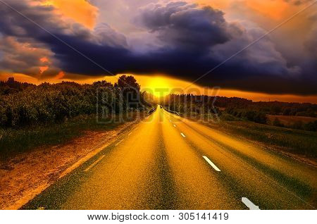 Beautiful sunny road in the morning. Beautiful sun rising sky with asphalt highways road and storm clouds, Driving on an empty road at lovely sunny day. Sun rising over asphalt country open road in sunny morning or evening. Open road at sunny sunset or su