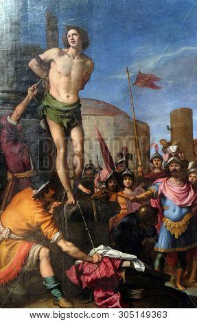 FLORENCE, ITALY - JANUARY 11, 2019: Martyrdom of saint Sebastian altarpiece in the Basilica di San Lorenzo in Florence, Italy