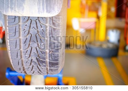 Cut Wheel, Flat Car Tire Repair In Garage, Replacing The Tires On The Car. Flat Tire. Attaching A Sp