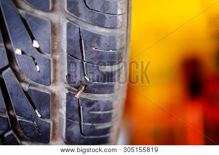 Cut wheel, Flat car tire repair, Replacing the tires on the car. Flat tire. Attaching a spare wheel. Lifting the car on the jack. Accident with punctured tires. Hard man work. poster