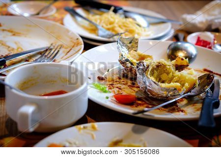 After Banquet Is Finished. Wasted Food On Served Festive Table After Lunch Party. Leftovers, Empty P