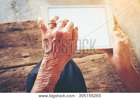 Close Up Of A Old Man Using Mobile Smart Phone,  Senior Woman Using Cell Phone Or Holding Finger On
