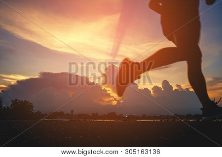 Runner's Feet, Motion Blurred Runner Closeup Shot  Runner Running At A Fast Pace Background Clouds S