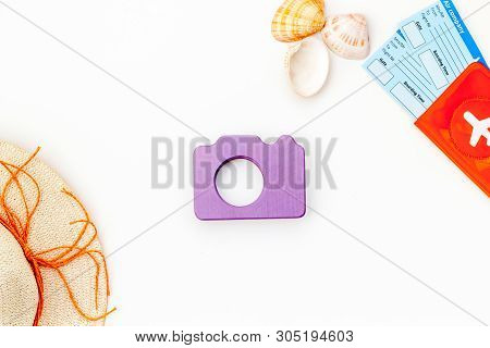 Camera, Hat, Passport And Tickets For Summer Photo At The Seaside On White Background Top View