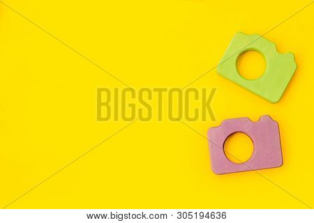 Photo Camera Concept On Yellow Background Top View Copy Space