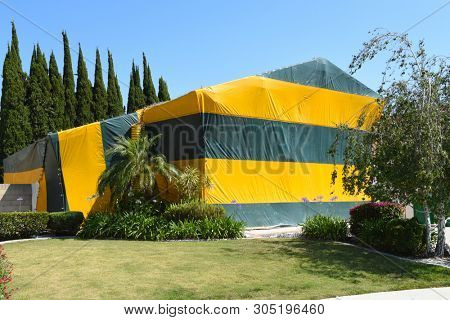 A two story house tented for Fumigation, a method of pest control for termites, that fills the house with gaseous pesticides.