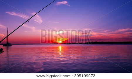 Australian Colourful Red Pink Cirrus Cloudy Sunset Seascape With A Bright Blue Sky And Sparkling Sea