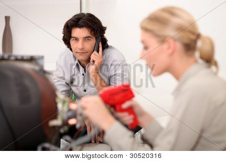 Technician fixing a television