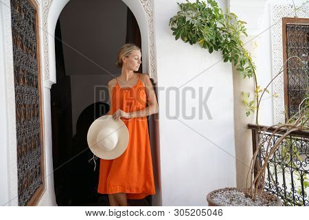 Beautiful woman on balcony in Moroccan riad poster