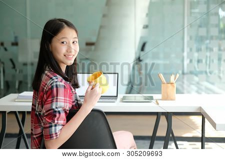 Asian Girl Teenager Posing At Co-working Space